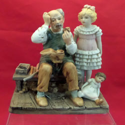 1d1a6cac2a761 The Cobbler Figurine by Norman Rockwell